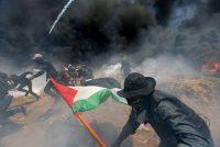 Palestinian demonstrators flee Israeli fire and tear gas during a protest on the Israel-Gaza border on Monday.CreditIbraheem Abu Mustafa/Reuters