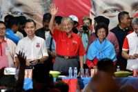 Former Malaysian prime minister and candidate for the opposition Alliance Of Hope, Mahathir Mohamad, waves to his supporters during an election campaign rally in Kuala Lumpur, Malaysia, on Thursday. (Stringer/Reuters)