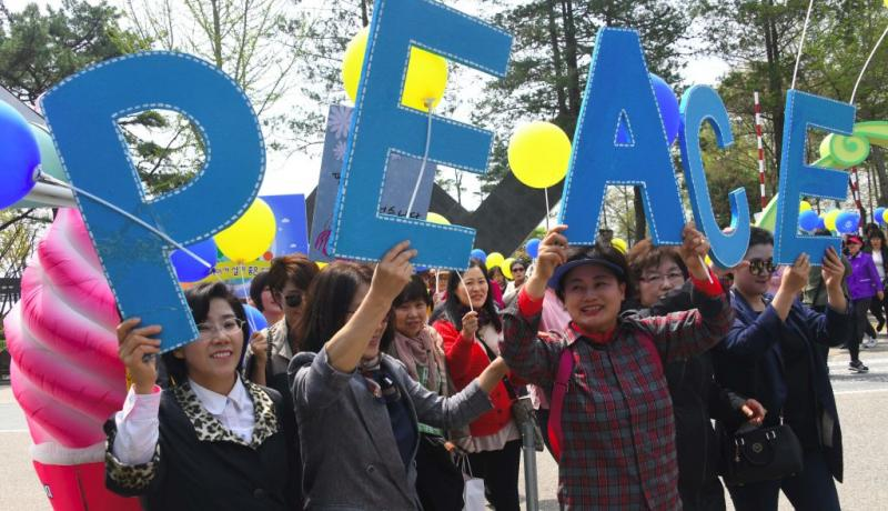 Women's peace group rally in Imjingak peace park in Paju, near the demilitarized zone dividing the two Koreas. Photo by Jung Yeon-je/AFP/Getty Images.