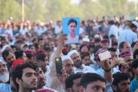 Supporters of Manzoor Pashteen, leader of the Pashtun Protection Movement, hold pictures of their missing relatives as they listen to his speech during a gathering in Swat, Pakistan, on April 29. (Naveed Ali/EPA-EFE/Shutterstock)
