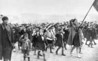 """Children singing """"The Internationale"""" in a communist-led May Day parade, Paris, France, 1934. Getty Images."""