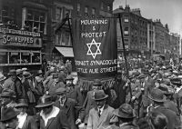 In 1919, Jewish men in Whitechapel, East London, marched to protest the killing of Jews in Poland.CreditTopical Press Agency/Getty Images