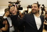 Lebanese Prime Minister Saad Hariri gives a thumbs-up with his ink-stained thumb after voting at a polling station in Beirut on May 6 as the country held its first parliamentary election in nine years. (Anwar Amro/AFP/Getty Images)