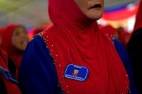 A supporter wears a lapel pin bearing a portrait of Prime Minister Najib Razak of the ruling coalition party Barisan Nasional during a campaign event in Kuala Lumpur, Malaysia, this month.CreditManan Vatsyayana/Agence France-Presse — Getty Images