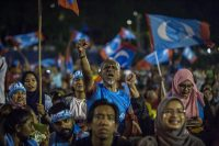 Supporters of Mahathir Mohamad in Kuala Lumpur, Malaysia, on Wednesday as they watched live televised results of his victory.CreditUlet Ifansasti/Getty Images