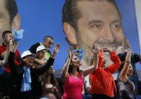 Supporters of Lebanese Prime Minister Saad Hariri, who is a candidate for the parliamentary elections to be held May 6, cheer in Beirut. (Hussein Malla/AP)