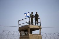Israeli soldiers guarding the Israel-Gaza border on Tuesday. (Ariel Schalit/AP)