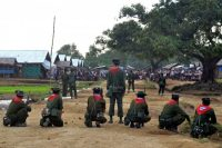 Burmese security forces stand guard during unrest at a camp for Muslim Rohingya refugees on the outskirts of the town of Sittwe in Rakhine State. (AFP)