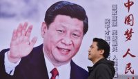 A poster promoting Xi Jinping's 'Chinese Dream' slogan in Beijing. Photo: Getty Images.