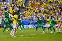 Yerry Mina dio un cabezazo para el gol contra Senegal. Credit Manan Vatsyayana/Agence France-Presse — Getty Images