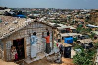 Rohingya refugees rebuild their makeshift house, in preparation for the approaching monsoon season at the Kutupalong Rohingya refugee camp in Kutupalong, Bangladesh. April 28, 2018. (A.M. Ahad/AP)