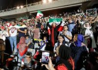 Supporters in Tehran cheer for the Iranian national team during a screening of its World Cup match against Spain on June 20. (AFP/Getty Images)