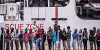 Migrants disembark the Italy's coastguard ship Diciotti at the port of Catania. Fabrizio Villa/Getty Images