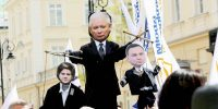 An effigy of the leader of the Law & Justice Party (PiS), Jaroslaw Kaczynski holding Premier Beato Szydlo and Polish President Andrzej Duda as puppets. Anna Ferensowicz/Pacific Press/LightRocket via Getty Images