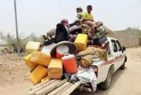 Yemenis, displaced from their homes in the war-torn port city of Hodeida, at a refu­gee camp in the northern district of Abs on June 22. (Essa Ahmed/AFP/Getty Images)