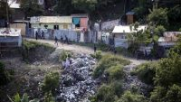 Police patrol a low income neighborhood in the capital city of Tegucigalpa, Honduras, Wednesday, Nov. 25, 2015, after several residents were pulled from their homes by armed young men and executed. Honduran police say more than a dozen people have died in two massacres within a span of 12 hours. Another eight were killed in the city of San Pedro Sula after armed men stormed a bus terminal and shot eight drivers one by one. It was a bloody 12 hours for Honduras, which only recently was designated the world's deadliest country for a nation not at war. (AP Photo/Fernando Antonio)