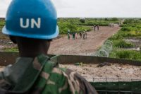 July 2016 – Malakal, South Sudan – A U.N. peacekeeper stands guard as civilians enter the Protection of Civilians (POC) site outside the United Nations Mission in South Sudan (UNMISS) compound in Malakal, South Sudan on Wednesday, July 13, 2016.(Jane Hahn for Washington Post)
