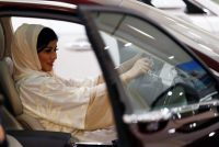 A Saudi woman checks her future car at a showroom ahead of being able to practice the right to drive.CreditFaisal Al Nasser/Reuters