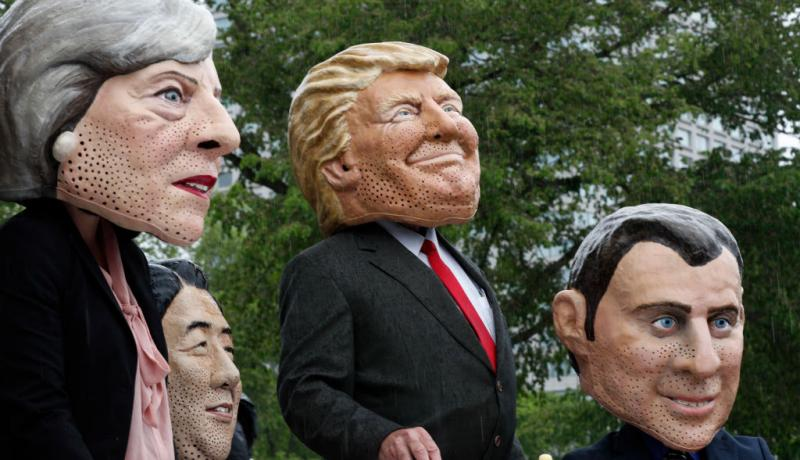 Members of OXFAM dress as G7 leaders ahead of the summit at Quebec in June 2018. Photo by Lars Hagberg/AFP/Getty Images