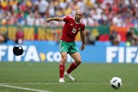 MOSCOW, RUSSIA - JUNE 20: Noureddine Amrabat of Morocco throws away his skull cap during the 2018 FIFA World Cup Russia group B match between Portugal and Morocco at Luzhniki Stadium on June 20, 2018 in Moscow, Russia. (Photo by Simon Hofmann - FIFA/FIFA via Getty Images)