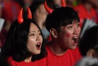 South Korean football fans react as they watch on a large screen the 2018 World Cup football match between South Korea and Sweden at Gwanghwamun square in Seoul on June 18, 2018. (Photo by Jung Yeon-je / AFP) (Photo credit should read JUNG YEON-JE/AFP/Getty Images)