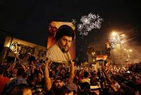 Supporters of Shiite cleric Moqtada al-Sadr celebrate their electoral success in Baghdad in May 2018. (Hadi Mizban/AP)