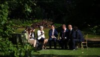 Theresa May speaks with other leaders at the Western Balkans summit in London. Photo: Getty Images.