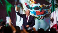 Andres Manuel Lopez Obrador greets supporters as election results come in on 1 July. Photo: Getty Images.