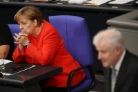 Chancellor Angela Merkel of Germany listened as Horst Seehofer, the interior minister and leader of the C.S.U., spoke last week.CreditSean Gallup/Getty Images