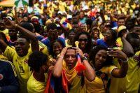Colombianos en Cauca reaccionan durante el partido de la tricolor contra Inglaterra. Credit Luis Robayo/Agence France-Presse — Getty Images