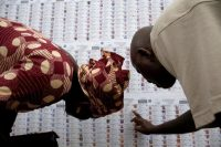 People look for their names on the electoral list at a polling station Monday in Bamako, Mali. Mali's presidential polls open Sunday in the first round of voting. (Luc Gnago/Reuters)