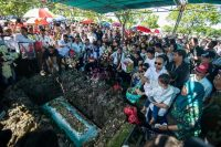 Relatives and friends of Aloysius Bayu Rendra Wardhana, who died in a blast at Santa Maria Tak Bercela Church, attend a funeral in Indonesia on May 23. (Juni Kriswantojuni/AFP/Getty Images)