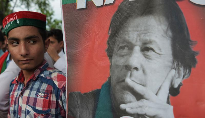 Supporters gather near the home of Imran Khan on 26 July. Photo: Getty Images.
