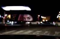 Hessah al-Ajaji drives her car on the capital's busy Tahlia Street after midnight for the first time in Riyadh, Saudi Arabia, on June 24. (Nariman El-Mofty/AP)
