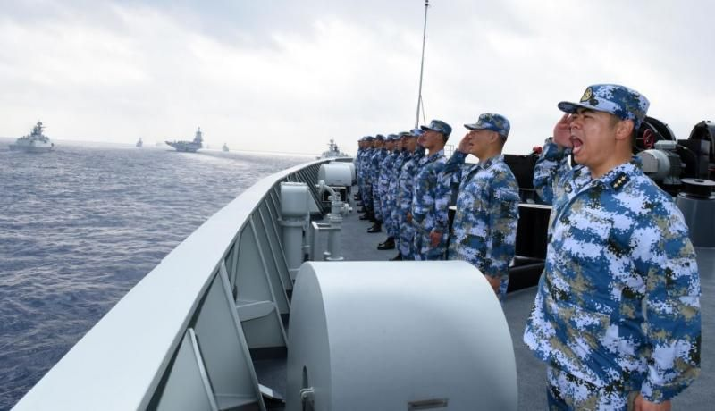 A PLA Navy fleet takes part in a review in the South China Sea on 12 April. Photo: Getty Images.