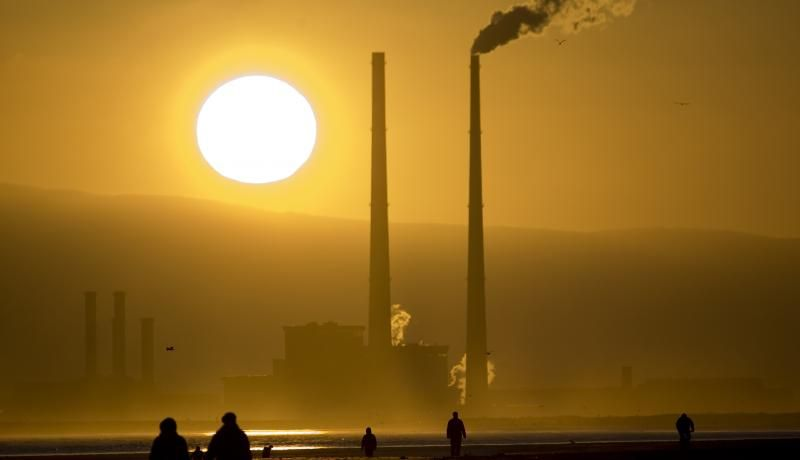 Sun setting behind a power station in Dublin, Ireland. Photo: Getty Images.