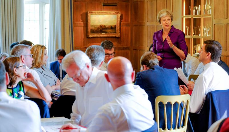 Theresa May speaks to her cabinet at Chequers on 6 July. Photo: Getty Images.