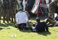 Injured people are attended to after an explosion at a Zanu PF rally in Bulawayo, Zimbabwe, on June 23. (AP)