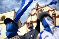 """Protesters at the """"March of Mocking"""" against President Daniel Ortega of Nicaragua and his wife, Vice President Rosario Murillo, in Leon, Nicaragua, last Saturday.CreditMarvin Recinos/Agence France-Presse — Getty Images"""
