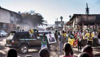 Supporters of the newly reelected Zimbabwe President Emmerson Mnangagwa celebrate in Mbare, Harare, on 3 August 2018. MARCO LONGARI / AFP
