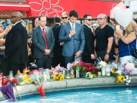 Prime Minister Justin Trudeau of Canada, center, paying his respects on Monday in Toronto where two people were killed and at least 13 injured in a shooting last month.CreditNathan Denette/The Canadian Press, via Associated Press