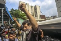 Bangladeshi photographer Shahidul Alam was detained by plainclothes police at his home on Aug. 5 after giving an interview to Al Jazeera about student demonstrations. (AFP/Getty Images