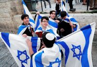 Israeli youths held national flags on Jerusalem Day in the Old City in May.CreditThomas Coex/Agence France-Presse — Getty Images
