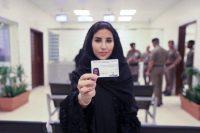 Esraa Albuti, an executive director at Ernst & Young, displays her brand-new driving license in Riyadh, Saudi Arabia, on June 4. (Saudi Information Ministry via AP)
