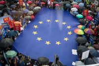 Protesters deploy a giant European flag in Warsaw on June 26. (Wojtek Radwanski/AFP/Getty Images)