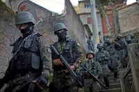 Members of the Brazil Armed Forces patrolling a favela in Rio de Janeiro in June.CreditMauro Pimentel/Agence France-Presse — Getty Images