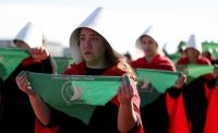 """Abortion-rights activists hold handkerchiefs with the Spanish message """"For a legal, safe and free abortion"""" while wearing costumes from """"The Handmaid's Tale"""" during a demonstration in Buenos Aires on Aug. 5. (Natacha Pisarenko/AP)"""
