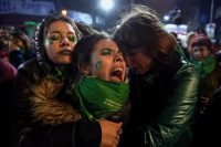 Activists in favor of the legalization of abortion comfort one another Thursday outside the National Congress in Buenos Aires after senators rejected the bill to legalize abortion. (Eitan Abramovich/AFP/Getty Images)
