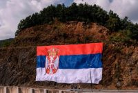A giant Serbian national flag was hung prior to the visit of Serbian president, Aleksandar Vucic, to Gazivode Lake in Kosovo on September 8, 2018.CreditCreditArmend Nimani/Agence France-Presse — Getty Images