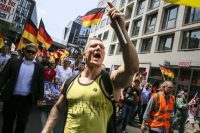 A protester shouts slogans during a demonstration in Berlin organized by the right-wing Alternative for Germany party. May 27, 2018. (Carsten Koall/Getty Images)